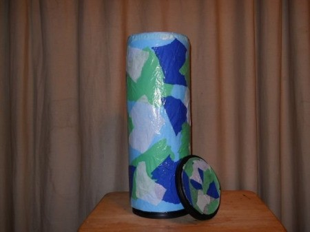 Coffee Container Toilet Roll Holder, covered in decorative tissue paper