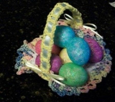 Crochet Easter basket with colored eggs.