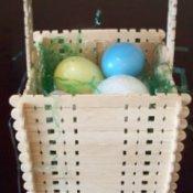 Easter basket made from wooden craft sticks.