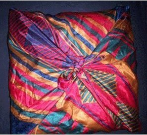 Pillows covered with scarves.