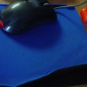 Fix That Mousepad, an old mousepad that is peeling up on the sides.
