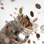 Coins Coming out of Glass Jar