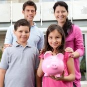 Frugal Family With Girl Holding Piggy Bank