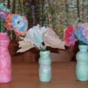 Drinkable yogurt bottle vases with paper flowers.