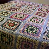 A colorful granny square afghan.