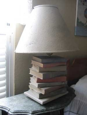 A lamp with stacked books as the base.