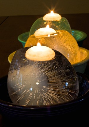 Melting Ice Candles in Bowls in a Row