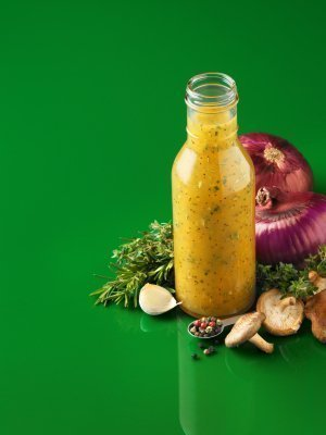 Italian Salad Dressing on Green Background