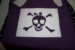 A pirate skull template cut out of freezer paper