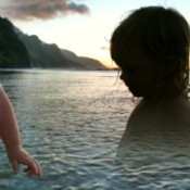 Spirit in the Ocean (Kee Beach, Kauai, Hawaii): a double image of a child in the water and running past.