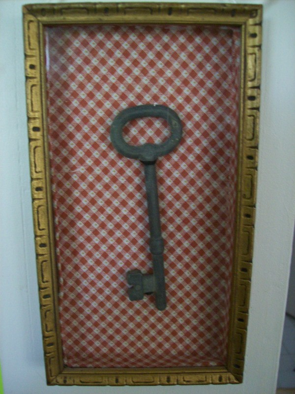 Heirloom Shadowbox with a skeleton key.