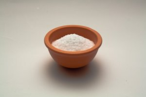 Salt in Bowl on White Background