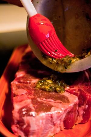 Spreading Marinade on Lamb Chops