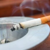 Cigarette Burning in Ash Tray