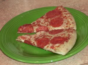 Two slices of Pepperoni on a plate
