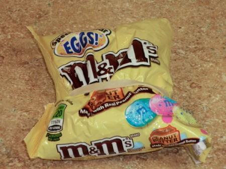 Using a rubber band to close M&M bag