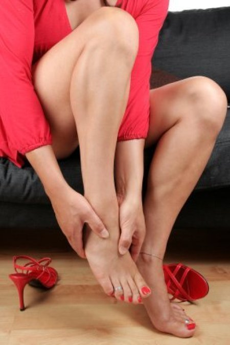 Woman Massaging her Feet After Removing Heels