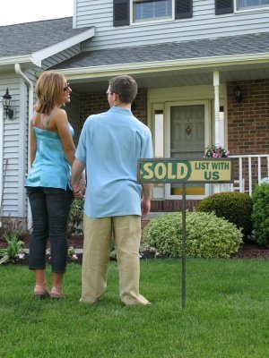 Couple Standing in Front of Their New House