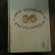 White leather volume of encyclopedia.