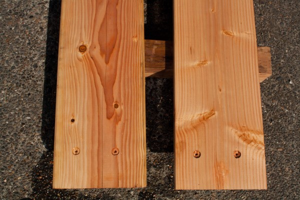 Square Foot Raised Garden Beds - Two Stained Boards Drying