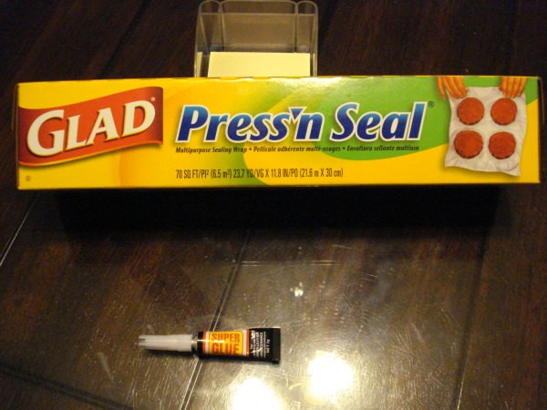 A box of Press'N Seal plastic wrap and a tube of super glue.