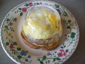 Quick Cheesy Egg On Toast - upend cooked egg cup on a slice of toast.