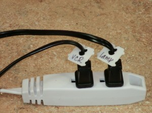 Bread ties marking cords on a power strip.
