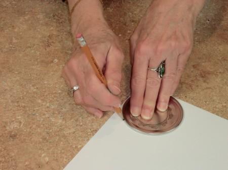 tracing lid shape onto scrapbook paper