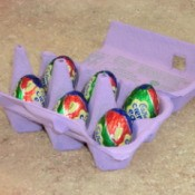 Cadbury eggs in painted egg crate.