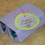 Filled egg crate with gift tag.
