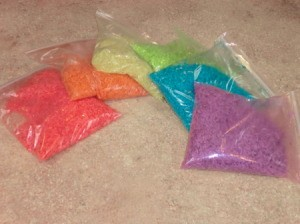 Bags of rainbow dyed rice.