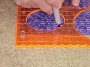 Tracing circle on fabric.