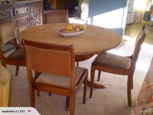 Round dining table and four chairs.