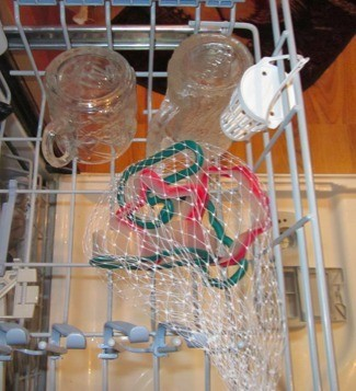 Cookie cutters inside a mesh bag in the dishwasher