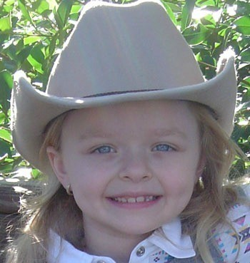 little girl in cowgirl hat