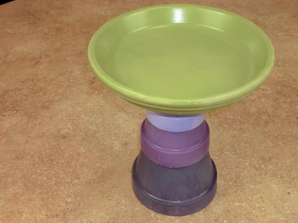 Large flower pot saucer glued to base.