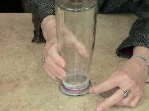 Wrapping yarn around vase.