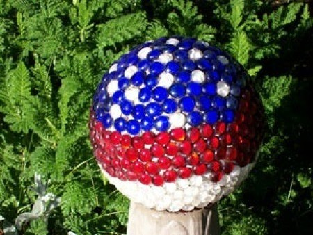 A patriotic garden ball in red, white and blue.