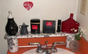 Homemade shelf behind the bathroom sink.