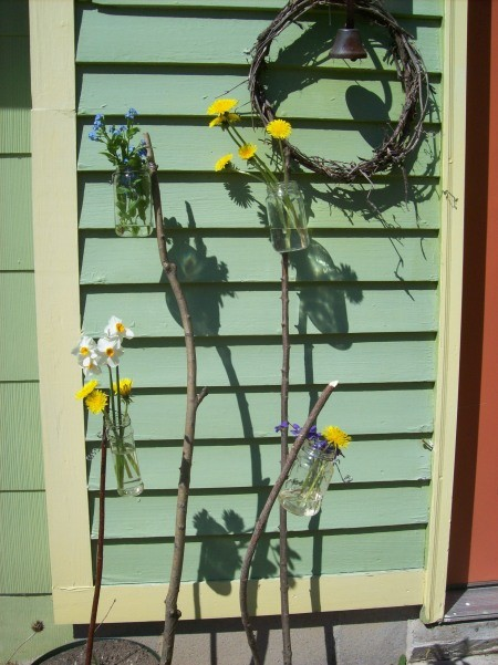 Recycled jar garden vases by the house.