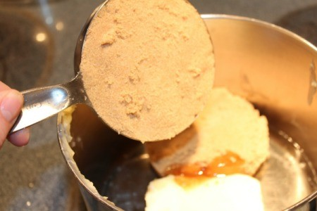 Adding brown sugar to pan with margarine, corn syrup, and salt