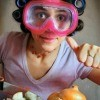 Wearing goggles while chopping onions.