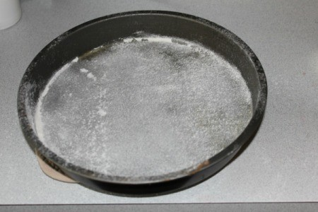 Round cake pan dusted with flour