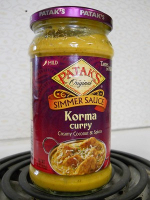 Curried chicken and rice, jar of Korma curry sauce
