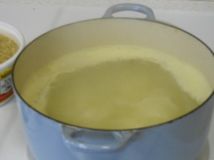 Curried chicken and rice, bringing water to boil