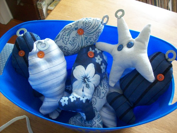 Homemade fishing game view of the finished fish and starfish in bucket.