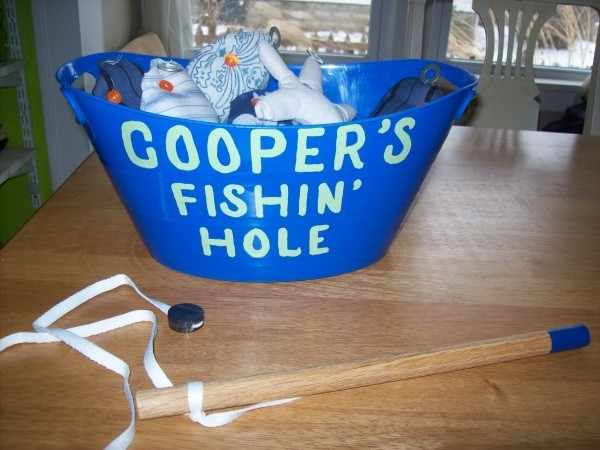 Homemade fishing game view of the bucket with pole.