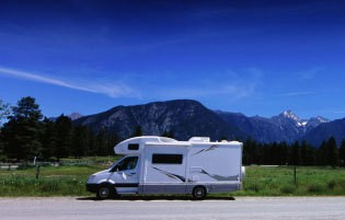 An RV out in a mountainous area.