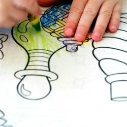 Child Coloring in a Coloring Book