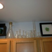 Chemistry equipment on top of kitchen cabinets.